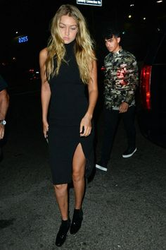 Gigi Hadid wearing Twin Sister Racer Bodycon Dress with Split and Saint Laurent Babies Chelsea Boots