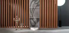 3-door column. Furniture piece made in Daquacryl® (PMMA veneer on particle board, in black or white) Thick doors with visual effect, 3 motifs available: ...
