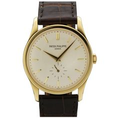Patek Philippe Yellow Gold Calatrava Wristwatch Ref 5196J | From a unique collection of vintage wrist watches at http://www.1stdibs.com/jewelry/watches/wrist-watches/