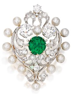 A Belle Époque Gold, Platinum, Emerald, Pearl and Diamond Brooch, Marcus & Co.
