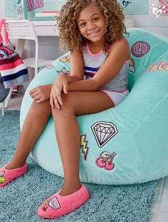 Our cozy varsity-themed bean bags, soft slippers and plush rugs are sure to make her smile.