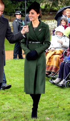 Kate Middleton's Christmas outfit: belted long green coat, brocade dress, hat, boots and gloves