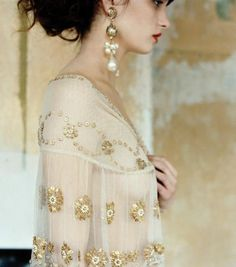 Love the earrings and the details of the dress/top.....