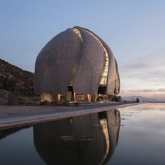 Torqued wings made of steel and glass feature in this Bahá'í temple in Chile by Hariri Pontarini