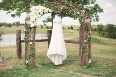 Rustic wedding arch with flowers.