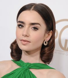 Actress Lily Collins arrives at the 28th Annual Producers Guild Awards at The Beverly Hilton Hotel on January 28 2017 in Beverly Hills California