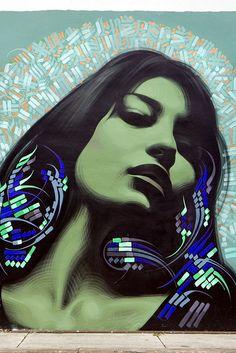 Street art murals by El Mac & Retna