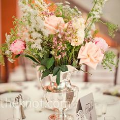 Liz collected antique silver and pewter water pitchers for the tables, and the florist took over from there -- adding pink in-season roses, peonies and stock.