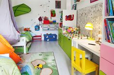 View of colourful shared kids' bedroom with a clever layout and multifunctional…