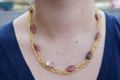 Braided Gold Beaded Triple Stranded Necklace with Semi Precious Pink Stones. $30.00, via Etsy.
