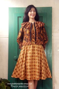 Batik Amarillis's Romancia dress & jacket  Tap into Batik Amarillis's ultra-feminine aesthetic  with this frill and bell sleeved dress,cut to 1950 and 1960s-inspired silhoutte,the bodice is accented with vertical frill while full skirt to add drama to the dress