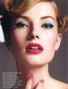 Gorgeous navy blue cat eye makeup combined with dark pink lips on model Joanna Stubbs.
