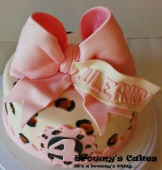 Pink bow & leopard print cake  Follow Browny's Cakes on instagram, facebook, twitter, blog, pinterest and Youtube channel