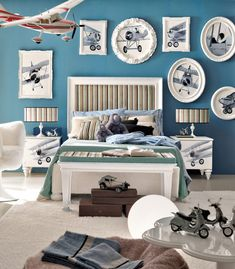 Little boys room....1 theme for the wall art (in this case bi-planes). Like the deep teal accent wall and the neutral colors in the pictures.....blends well with the wall.