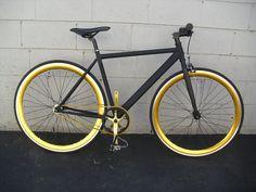 Black bike with golden parts