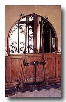Style Art Nouveau...can't tell if it's an architectural element or a door or a piece of furniture, but it's very beautiful.