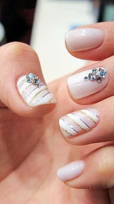 Nails. Nail Art. Light pink with jewels and stripes! So coot!