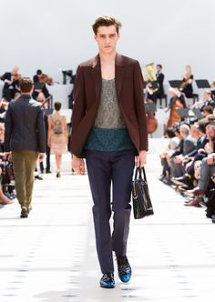 Burberry Spring/Summer 2016. Vest in peacock blue lace cotton, wool mohair tailoring and patent leather Derby shoes with a mineral blue toe cap