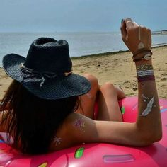 www.ethnikk-tattoo.com sur Instagram: Hello les filles !  #tattoos Feeling Tropical posés sur la jolie @elise_et_mood en mode bronzette sur la bouée Donuts. #tattoo #Bijou #bijoux #jewelrytattoo #ootd #girl #flamantrose #palmertattoo #flamingo #love #picoftheday #beautiful #photooftheday #instagood #fun #smile #pretty #lady #swag #cool #fashion #igers #instagramers #style #fun #vacances #summer #été