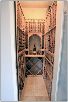 We Make It Happen With The Proper Assembly Tools - The client's finished wine cellar also sports our custom LED lighting, along with a compact but highly functional Cellarpro wine refrigeration unit.