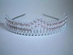 This tiara is 1.5 inches or 4 cm high at its highest peak and is adorned with 74 lovely pink crystals. This tiara is sent to you with a keepsake