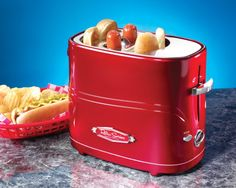 The Nostalgia Electrics Retro Pop Up Hot Dog Toaster holds up to 2 regular sized hot dogs & 2 hot dogs buns at one time. Toaster has adjustable heat control, removable hot dog basket and drip tray, and the mini tongs are included. Hot Dogs, Hot Dog Buns, Cool Kitchen Gadgets, Cool Kitchens, Quirky Kitchen, Red Kitchen, Kitchen Dining, Kitchen Tools, Kitchen Stuff