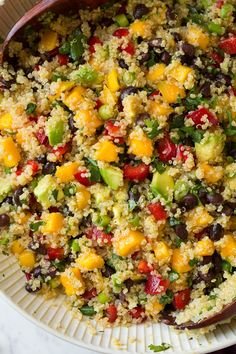Mango Black Bean Avocado Quinoa Salad. Substitute Vegetable broth for the chicken broth to make it vegan