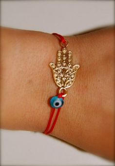 Naz Red String Gold Plated Hamsa Evil Eye Bracelet by NAZMAYA. $15.00. 100% silk boat knob finished, adjustable red string gold plated silver Hamsa charm evil eye bracelet.In ancient Mediterranean cultures, the evil eye bracelets are believed to provide protection from the envious eyes of others and ensure physical well-being.