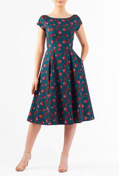 Our fit-and-flare dress is cut from light cotton in a vibrant floral print and topped with a boat neck and cap sleeves.