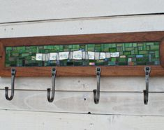 Our mosaic coat racks are a great way to dress up a functional item, and add a bit of color and texture in unexpected places. These wall-mounted coat racks are made-to-order in custom colors with your choice of 2, 4, or 6 hooks. Hooks are available in two styles, a classic U and a modern V. We can even incorporate your mementos into the mosaic to make this a truly unique and personal work of functional art. To create these coat racks, our mosaic artist Johannah first selects an assortment of…