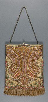 Purse Made in United States Early 20th century Artist/maker unknown, American Woven beadwork, beaded fringe, gold metal chain and frame with enameling, tan silk moiré 8 1/4 x 7 inches (21.0 x 17.8 cm)