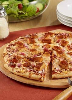Easy BBQ Chicken Pizza: BBQ chicken pizza made with saucy BBQ chicken, red onion and Italian blend cheese on prebaked crusts for an easy weeknight dinner