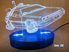 Show your love for Back to the Future with this light display featuring the Delorean time machine. The detailed image of everyones favorite flying car is laser engraved into clear acrylic, and illuminated by energy-saving LED lights. The result is something so futuristic that even Doc and Marty would be impressed.  Set this desk lamp next to your computer, on a bedside table, by your entertainment center, or alongside your other sci fi movie memorabilia. You can change the colour (red…