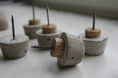 Concrete drawer pulls. Use cork for spacer/prevent scratching on cabinet/closet doors