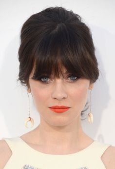 Zooey Deschanel is good hair inspiration for me because our hair is generally the same color and she's got thick bangs as well. I want a style I can wear with my bangs down like this.