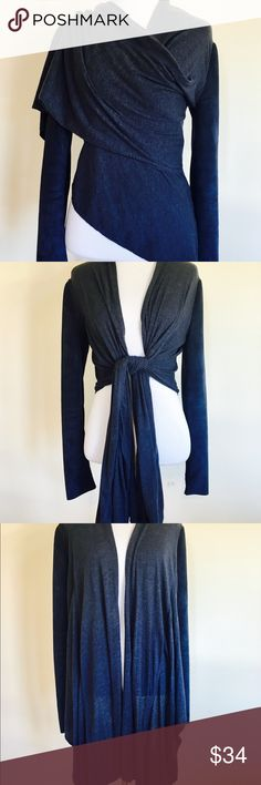 BCBG MAX AZRIA Navy Wrap wool faux suede Sweater Just in time for Fall. This is a beautiful wrap style cardigan by BCBG Max Azria with an interesting mix of knitted fabric and suede like panels in the sleeves and back. Hi Lo design and a variety of ways to wear it.  * Size XS * Machine wash cold BCBGMaxAzria Sweaters