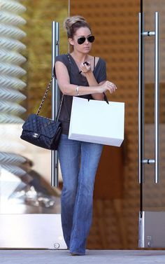 Love the simplicity of a good pair of jeans and classic pieces like a chanel flap and raybans
