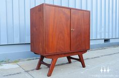 Danish modern mid century low bar cabinet constructed in beautiful old growth teak.