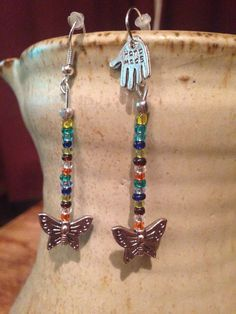 Seed bead drop earrings with Tibetan silver butterfly detail.