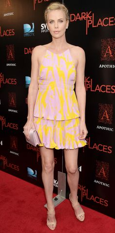Charlize Theron in a light pink-and-yellow silk Dior top and skirt.