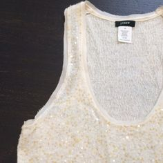 J. Crew Sequined Knit Tank Work Week Chic HPBest in Tops HP Lambs wool and cashmere sequined, racer back tank. Sequins are tiny, in gold and clear. Delicate, lightly frayed edges along neckline and arms. Adorable alone or under a jacket. A J. Crew classic in excellent condition from the mid '90's. J. Crew Tops Tank Tops