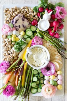 Re-create this beautiful and fresh spring inspired Easter Crudites and Cheese Board for your Easter appetizer.