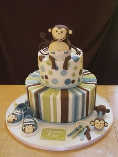 baby shower.  the baby shoes and rattle out of fondant covered stryo. balls, baby keys were gumpaste ring and fondant keys, monkey on top was done out of rice krispy treats and covered in fondant.  Cake covered in bc with fond. accents.  TFL!
