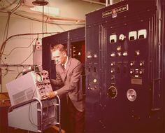 #GE employee working with an oscilloscope in the early 1960s.