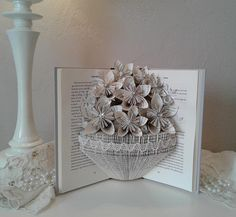 Check out this item in my Etsy shop https://www.etsy.com/listing/594835464/altered-book-book-bouquet-origami