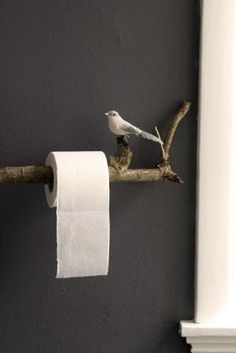 Inspiring idea -- If the branch was large enough it could also make a cute towel rack or curtain rod