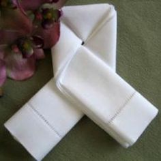 Planning a memorable engagement dinner? The lovers knot symbolizes the unity between two people. The lovers knot napkin fold is easy to do but takes a bit of practice.