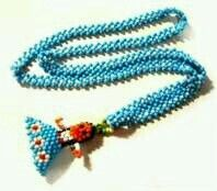 Native Style Glass Beaded Doll Necklace - lost on the playground of East Point