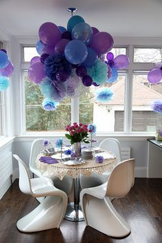 Balloons and Pom Poms hung in a bunch