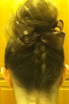 Upside down dutch braid into a messy bun. Add a bow if you like. Sorry, it's kind of gross, just got done playing in the snow!